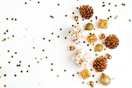 Photo pour Flat Lay with Christmas golden deco baubles on white. Copy Space. Horizontal. - image libre de droit