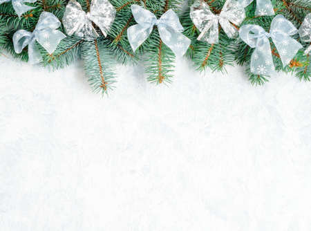 Christmas Border tree branches with golden decor isolated on white, horizontal banner