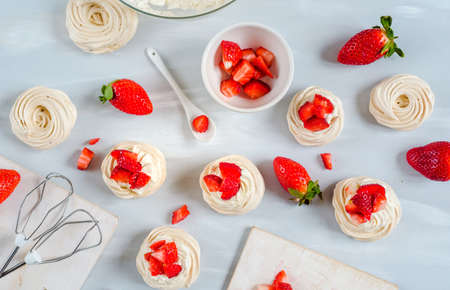 Photo for Two strawberry and cream meringue nest as dessert. - Royalty Free Image