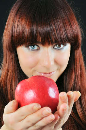 smiling girl hold on hand red apple