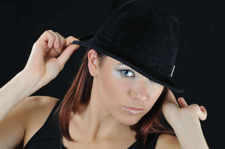 beautiful girl hold on the hat two hand