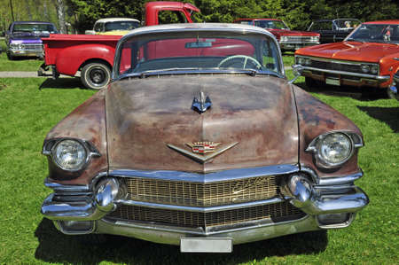 Heby, Sweden-May 15: Exhibit of old 50 th 60 th 70 th American classic cars and in the front an old brown Cadillac. May 15, 2010 in Heby.