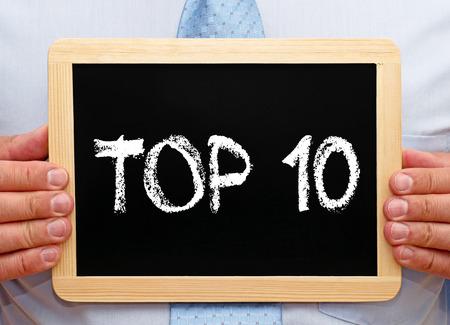 Photo pour Top 10 - Businessman with chalkboard - image libre de droit