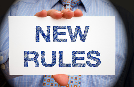 New Rules - Businessman with sign