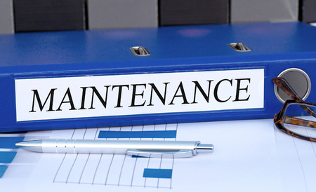 Maintenance - blue binder in the office