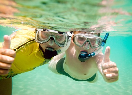 Two children under water in masks
