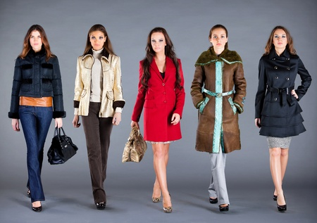 Photo pour Five girls in different clothes, autumn winter collection clothes - image libre de droit
