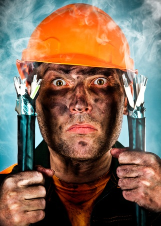 Electric shock sees a shocked electrician man