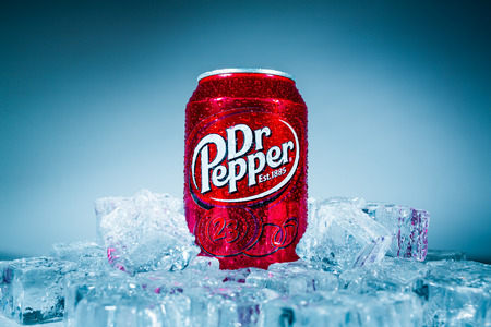 MOSCOW, RUSSIA-APRIL 4, 2014: Can of Dr Pepper soft drink on ice. Dr Pepper is a soft drink marketed as having a unique flavor. The drink was created in the 1880s.