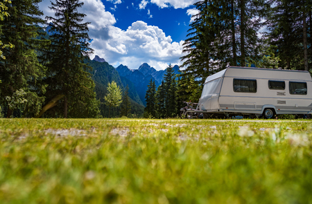 Foto de Family vacation travel, holiday trip in motorhome RV, Caravan car Vacation. Beautiful Nature Italy natural landscape Alps. - Imagen libre de derechos
