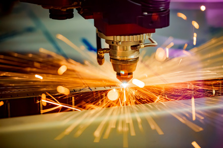 Photo pour CNC Laser cutting of metal, modern industrial technology. Small depth of field. Warning - authentic shooting in challenging conditions. - image libre de droit