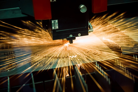 Photo for CNC Laser cutting of metal, modern industrial technology. Small depth of field. Warning - authentic shooting in challenging conditions. - Royalty Free Image