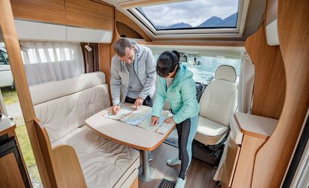 Photo for Couples in RV Camper looking at the local map for the trip. Family vacation travel, holiday trip in motorhome, Caravan car Vacation. - Royalty Free Image
