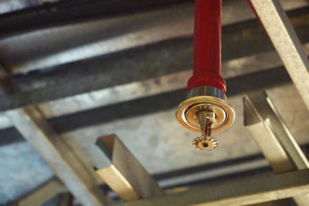 Photo for Automatic Fire ceiling Sprinkler in red water pipe System - Royalty Free Image