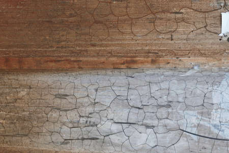 metal sheet wall covered with old enamel paint with a cracks line