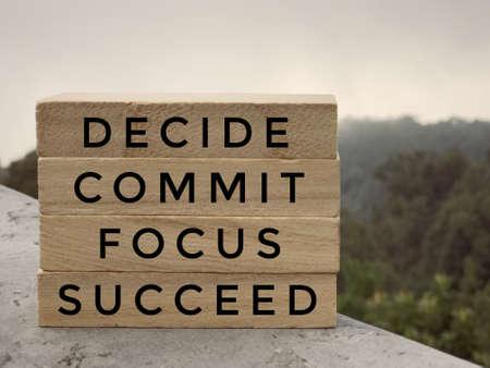 Foto de Motivational and inspirational words - Decide, Commit, Focus,Succeed written on wooden rectangular blocks. - Imagen libre de derechos