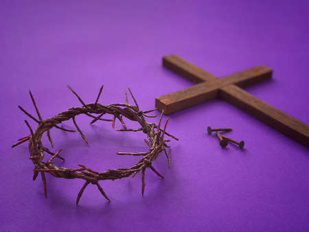 Photo for Good Friday, Palm Sunday, Ash Wednesday, Lent Season and Holy Week concept. A woven crown of thorns, three rusty nails and a Christian cross on purple background. - Royalty Free Image