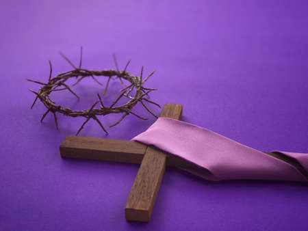 Photo for Good Friday, Lent Season, Ash Wednesday and Holy Week concept. A woven crown of thorns and a Christian cross on purple background. - Royalty Free Image