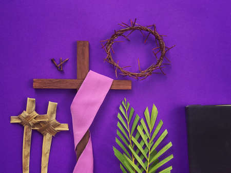Photo for Good Friday, Lent Season, Palm Sunday, Ash Wednesday and Holy Week concept.  A Christian cross, three rusty nails, woven crown of thorns, crosses made of palm leaves, palm leaves and a bible on purple background. - Royalty Free Image