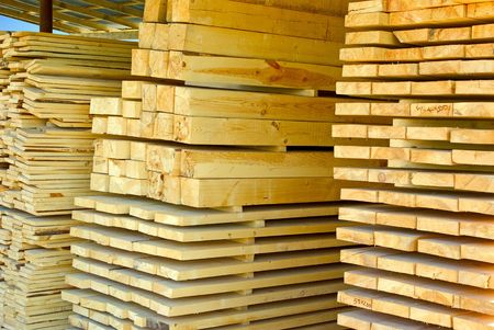 Assorted stacked lumber on stock of commercial timber