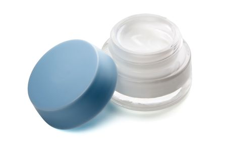 Open jar of cosmetic face cream isolated on white