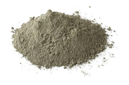 Photo pour Pile of dry grey portland cement isolated on white - image libre de droit