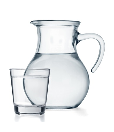A glass and a jug full of water isolated on white background