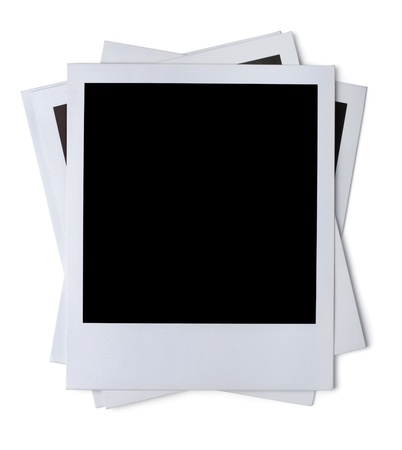 Photo pour Stack of blank paper photo frames isolated on white - image libre de droit