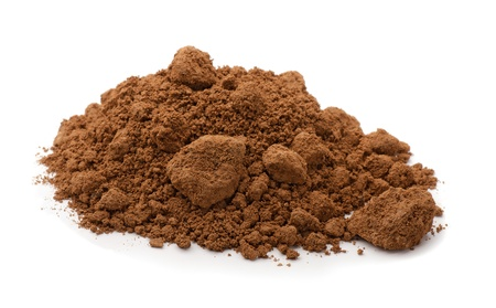 Pile of brown raw clay isolated on white