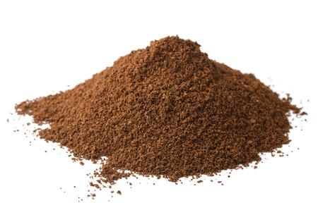 Pile of fresh ground coffee powder isolated on white