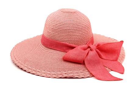 Foto de Pink straw hat with bow isolated on white - Imagen libre de derechos