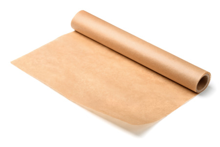 Roll of baking parchment paper isolated on white