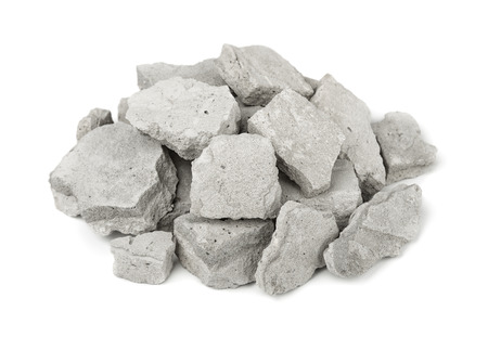 Foto de Pile of concrete rubble isolated on white - Imagen libre de derechos