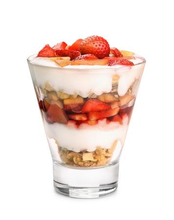 Glass of fruit and yogurt parfait isolated on white