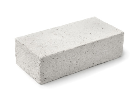 Foto de Lightweight foamed gypsum block isolated on white - Imagen libre de derechos