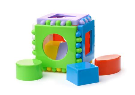 Photo pour Plastic shape sorter cube and blocks isolated on white - image libre de droit