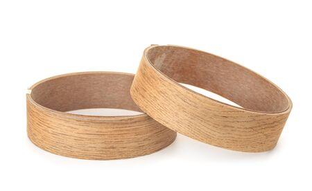 Photo pour Two rolls of decorative wood molding trims isolated on white - image libre de droit