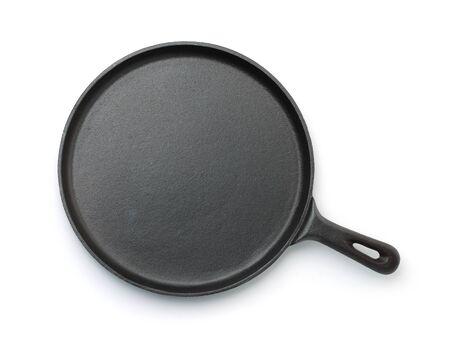 Photo pour Top view of cast iron crepe pan isolated on white - image libre de droit