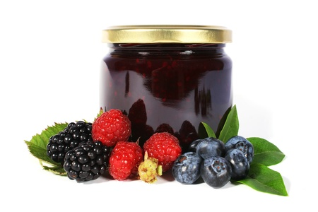 glas of jam with blueberries and raspberries
