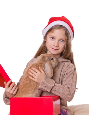 girl on christmas with a rabbit in a red present box