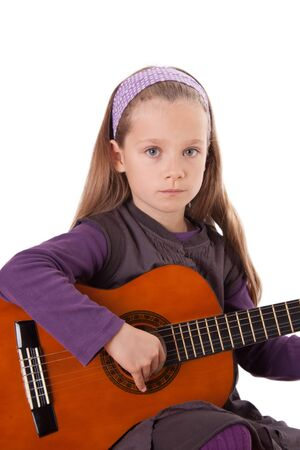 A young girl is playing a guitar.