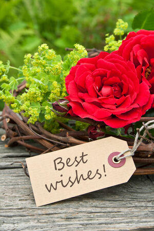 card with red roses and lettering Best wishes