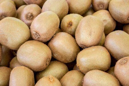 Display with lots of fresh kiwi fruit