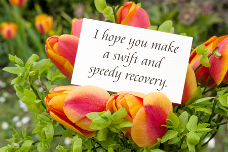 Greeting card with tulips and English text: I hope you make a swift and speedy recovery