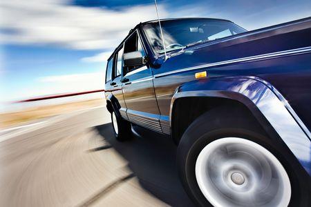 Foto de Blue Car in motion with deep blue sky - Imagen libre de derechos
