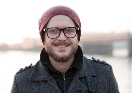 Foto de Portrait of young smiling hipster with moustache and beard - Imagen libre de derechos