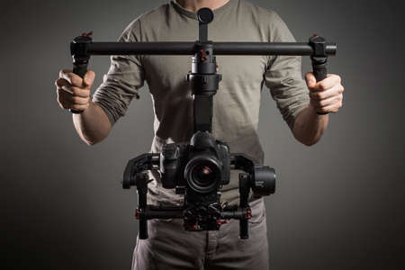 Photo for Professional videographer with gimball video slr - Royalty Free Image