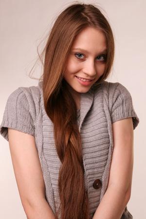 Portrait of pretty girl in grey woolen shirt.