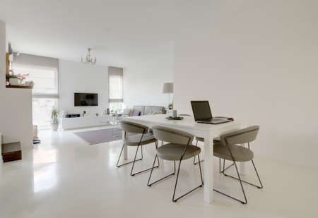 Photo pour image of modern white dining and living room - image libre de droit