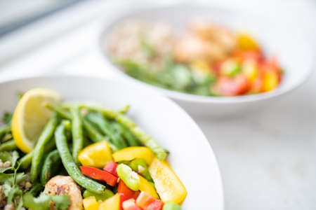 Photo for Meat and buckwheat dishes with green beans and tomato - Royalty Free Image